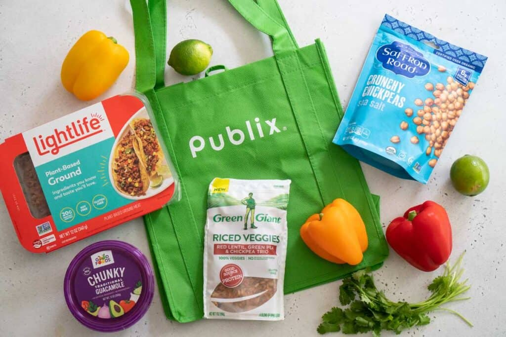 overhead view of publix reusable bag with vegetarian products surrounding