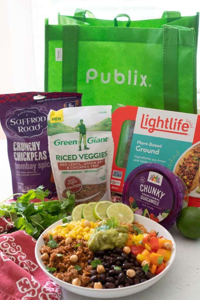 burrito bowl in front of reusable publix bag and vegetarian products