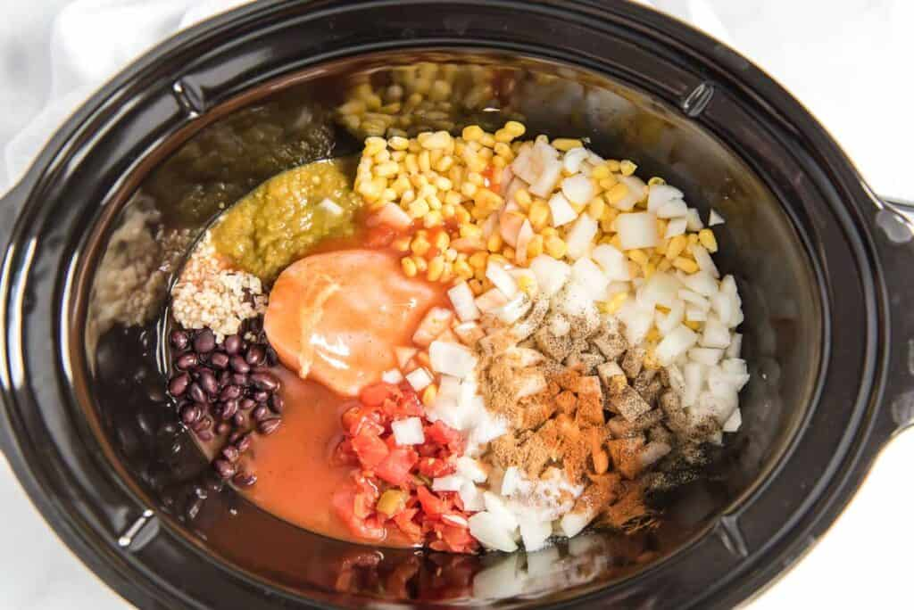 overhead view of chicken tortilla soup ingredients in slow cooker