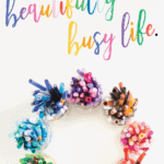 overhead view of colored pencils with writing that says beautiful busy life