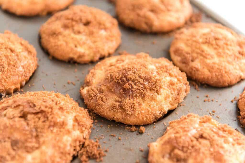 cinnamon apple muffins in baking tin