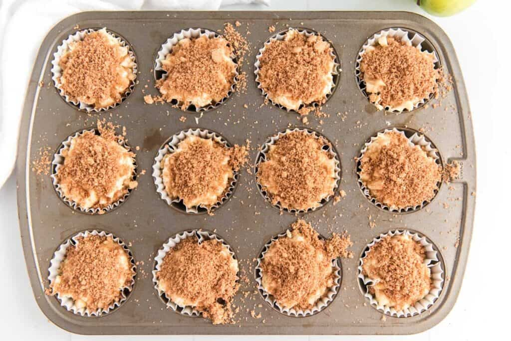 cinnamon apple muffins in tin before baking