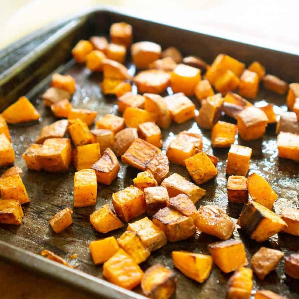 roasted diced sweet potatoes on baking sheet