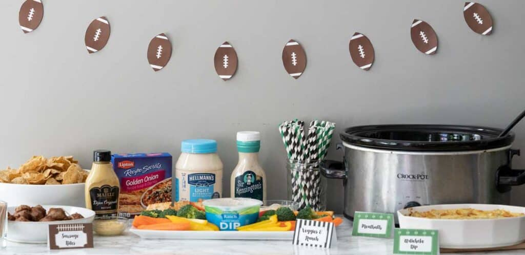 buffet of party food with football banner