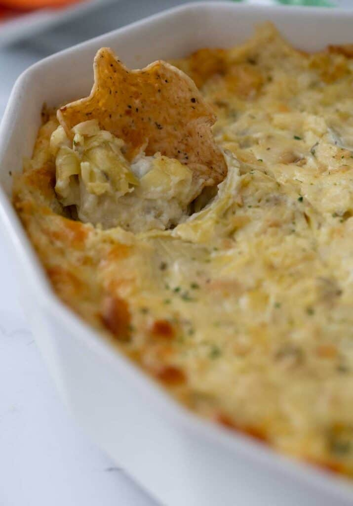 tortilla chip in artichoke dip