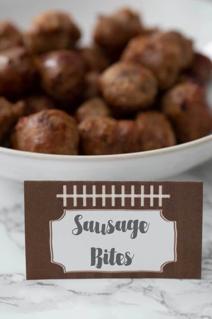 sausage bites in white bowl with football label