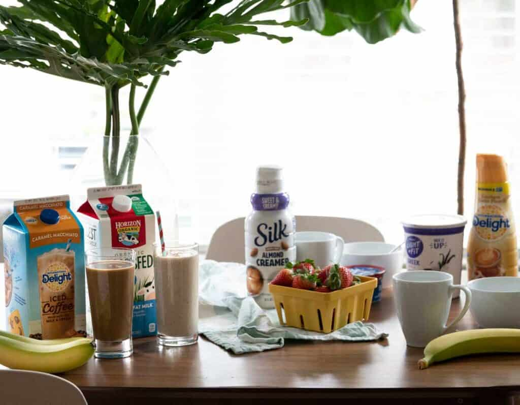 table with breakfast foods and smoothies